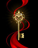 Golden key with a Fleur de Lis Royalty Free Stock Images