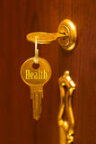 Golden key Health. Abstract medical concept Royalty Free Stock Image