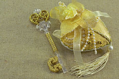 Golden key with heart. Vintage still life with the golden key, the decorated heart and copy space Royalty Free Stock Photos