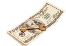 Golden key on hundred dollar bill Stock Photography