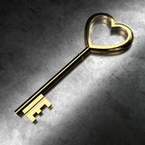 Golden Key on Black Metallic Background. 3D Rendering. Golden Key on Isolated Black Metallic Background. 3D Rendering Royalty Free Stock Photography