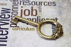 Golden key on job text Royalty Free Stock Photos
