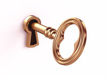 Golden key in keyhole Royalty Free Stock Photo
