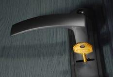 Golden key at keyhole Royalty Free Stock Photography