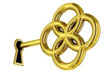 Golden key in keyhole Stock Photography