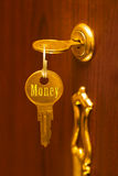 Golden key Money Royalty Free Stock Image