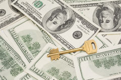 Golden key on money background Stock Images
