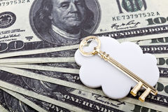 Golden key and money Royalty Free Stock Photo