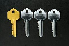 Golden key among ordinary keys Stock Photography