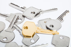 Golden key. On a pile of keys Royalty Free Stock Image