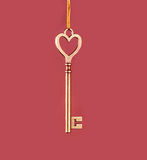 Golden key on a pink background Royalty Free Stock Image
