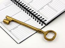 Golden Key On A Daily Planner Stock Image