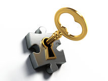 Golden key and puzzle Royalty Free Stock Images