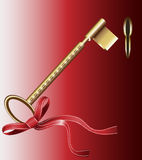 Golden key at red door Stock Image