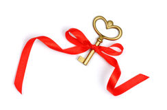 Golden key with red ribbon Royalty Free Stock Image