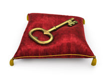 Golden key on royal red velvet pillow isolated on white backgrou Stock Image