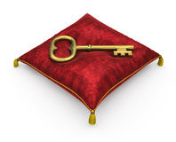Golden key on royal red velvet pillow isolated on white backgrou Royalty Free Stock Images