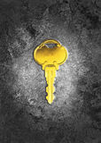 Golden key. On rusted grunge background Royalty Free Stock Photo