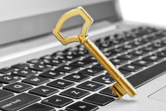 Golden key symbol of security in Internet. Stock Photos