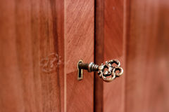 Golden key to antique furniture Stock Image