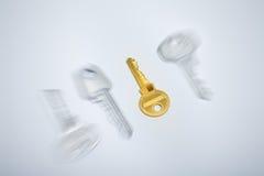 Golden key to success Stock Photos