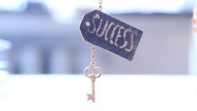 Golden key to success stock footage