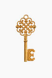 A golden key. On white with clipping path Stock Images