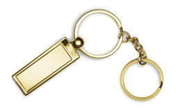 Golden keychain on white background Royalty Free Stock Photography