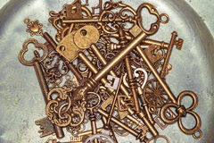 Golden keys on iron plate Stock Photo