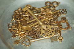 Golden keys on iron plate Royalty Free Stock Images
