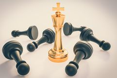 Golden King and many fallen pawns - chess leadership concept. Golden King and many fallen pawns around - chess leadership concept. 3D rendered illustration stock illustration