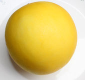 Golden king melon. Cucumis melo var inodorus, smooth skinned mini size melon with bright golden yellow skin and white crisp flesh and small seed cavity stock photo