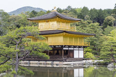 Golden Kinkaku-ji. Famous Golden Pavilion Kinkaku-ji in Kyoto Japan and its surrounding beautiful park Royalty Free Stock Photos