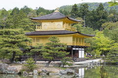 Golden Kinkaku-ji. Famous Golden Pavilion Kinkaku-ji in Kyoto Japan and its surrounding beautiful park Royalty Free Stock Images