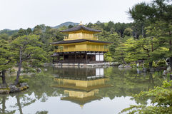 Golden Kinkaku-ji. Famous Golden Pavilion Kinkaku-ji in Kyoto Japan and its surrounding beautiful park Stock Image