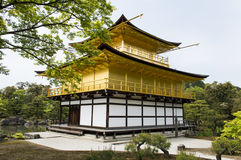 Golden Kinkaku-ji. Famous Golden Pavilion Kinkaku-ji in Kyoto Japan and its surrounding beautiful park Royalty Free Stock Photography