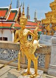 A Golden Kinnara statue at the Temple of the Emerald Buddha, Thailand. Royalty Free Stock Image