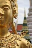 Golden kinnari bangkok grand palace thailand. Detail of golden kinaree statue in bangkoks majestic grand palace thailand Stock Images