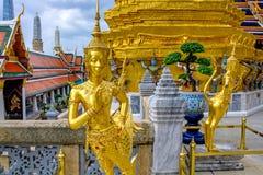 Golden Kinnari statue at Temple of Emerald Buddha.  Bangkok, Thailand Stock Image