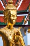 Golden Kinnari statue at Temple of Emerald Buddha (Wat Phra Kaew Royalty Free Stock Photo