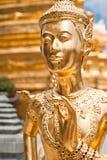Golden Kinnari statue at Temple of Emerald Buddha (Wat Phra Kaew Stock Image