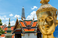 Golden Kinnari statue at Temple of Emerald Buddha (Wat Phra Kaew Stock Photography