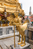 Golden Kinnari statue at temple,Wat Phra Kaew in Grand Palace Stock Photography