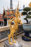 Golden Kinnari statue at temple,Wat Phra Kaew in Grand Palace Stock Image