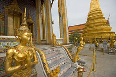 A Golden Kinnari statue in Wat Phra Kaew, Bangkok, Thailand Stock Photos