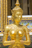 Golden Kinnari statue at Wat Phra Kaew, Bangkok, Thailand Stock Photos