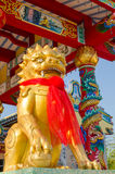 Golden kirin sculpture. In front of chinese shine royalty free stock images