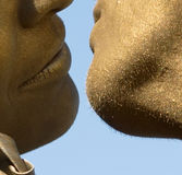 Golden kiss. Boy and girl in a gold paint kiss Royalty Free Stock Images