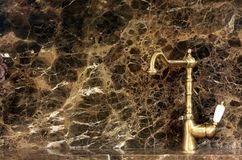 Golden kitchen tap Stock Photos