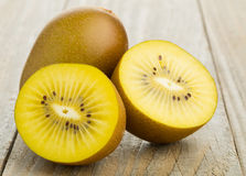 Free Golden Kiwifruit/ Kiwi Cut And Whole Royalty Free Stock Images - 52662039